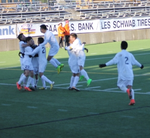 HRVHS Boys soccer team celebrate their second goal on a 2-0 5A Soccer State championship win over Woodburn.
