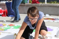 Freshman Sophie Larson-Teskey painting during hall decorating on Sunday.