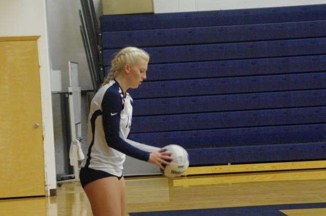 Kennedy James prepares to serve the ball.