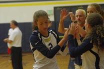 Hannah McNerney high fives her team members
